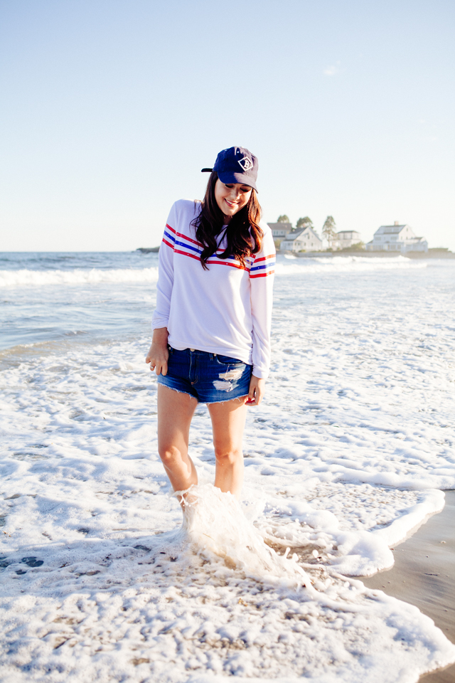 Kendi Everyday wearing a Wildfox Striped Sweatshirt and denim cut Offs on the beach