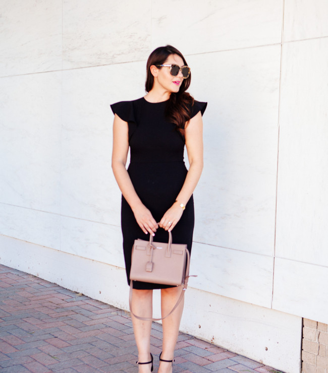 Kendi Everyday in Little Black Dress with Ruffle Sleeves.