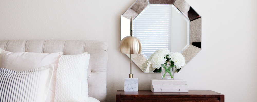 Bed and nightstand styled to show how to be a morning person