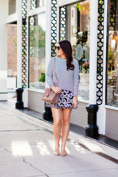 Floral skirt with striped tee and nude flats on Kendi Everyday.