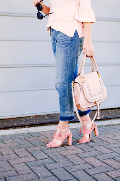 Pink Bell sleeve sweater with raw edge denim and maxwell tassel pink heels.