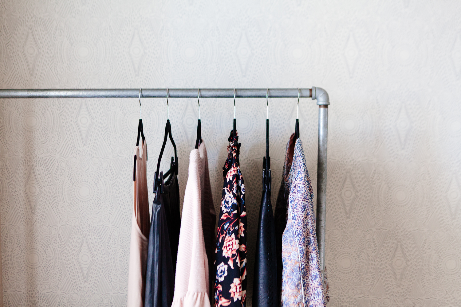 rack-of-clothes-on-wallpaper-wall-1