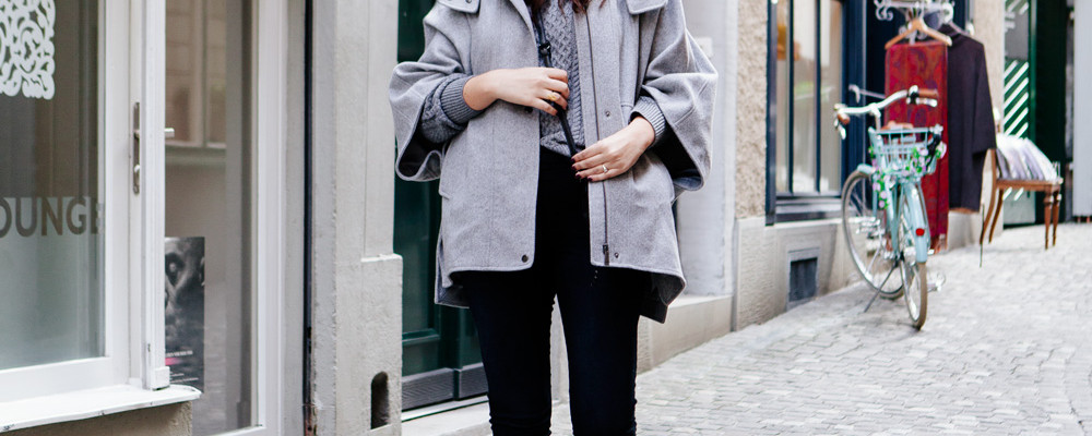 Grey cape and grey sweater on Kendi Everyday