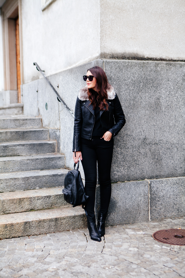 Black moto jacket with fur collar and black denim on Kendi Everyday
