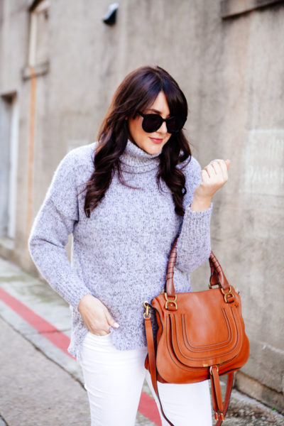 Grey cowl neck sweater with white denim and OTK boots on Kendi Everyday