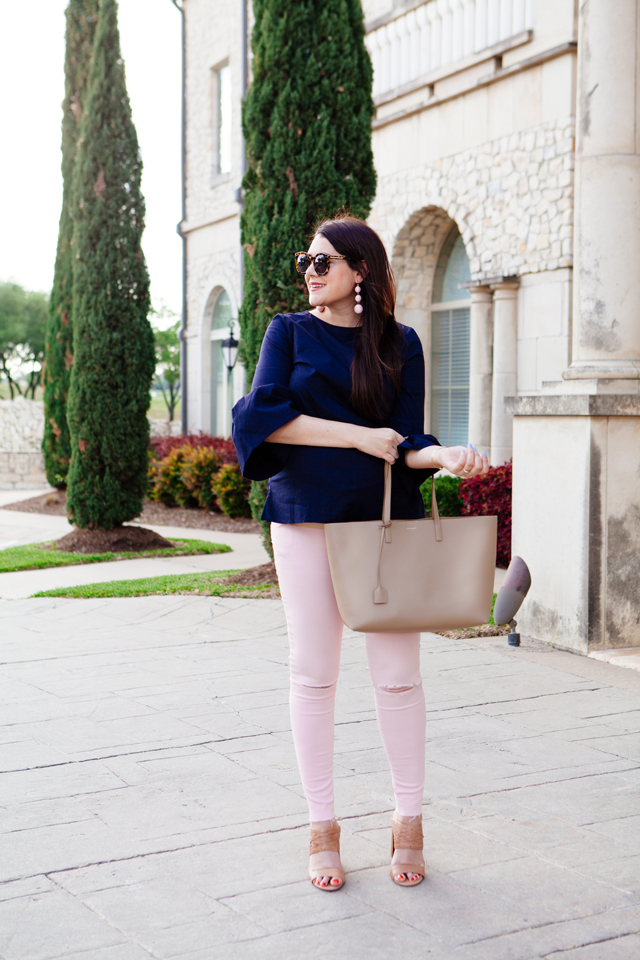 Bell sleeve top with pale pink skinny jeans.