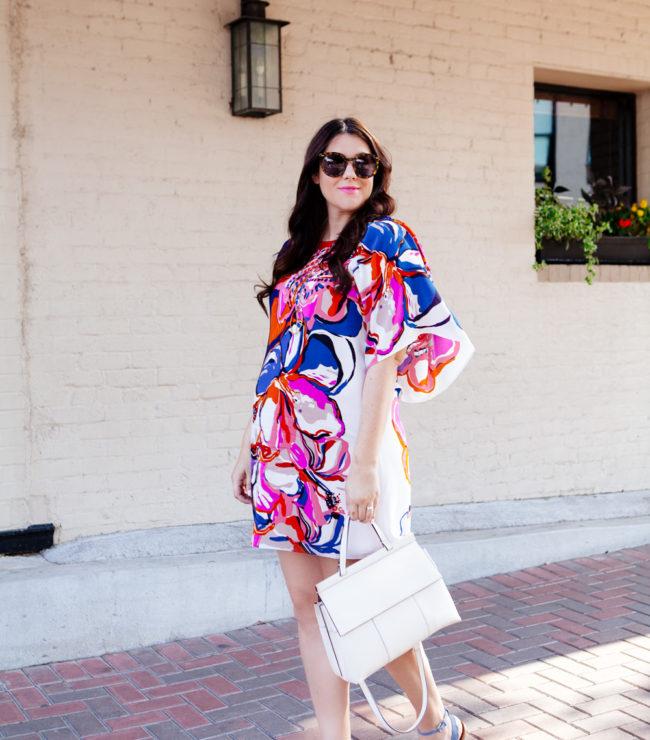 Silk floral dress with white handbag